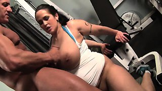 Voluptuous brunette Carmella gets her wet peach worked out in the gym