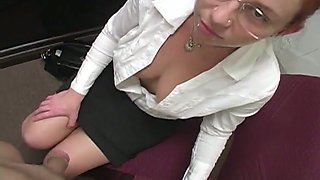 Redheaded boss wants to get raunchy with her new office assistant's cock