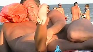 Nudist beach voyeur watches sexy babes enjoying the sun