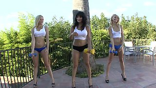 Three mind blowing chicks is doing exercises outdoor