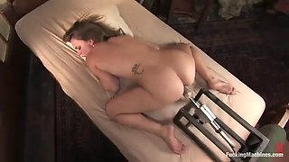 horny blonde cums over a machine while fucking it