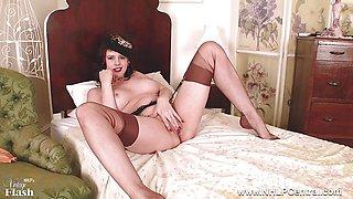 Milf Karina Currie dildos toy to orgasm in stockings suspenders