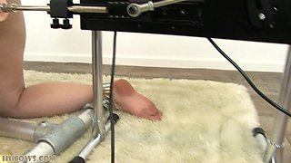 Submissive blonde tied to milking and fucking machine