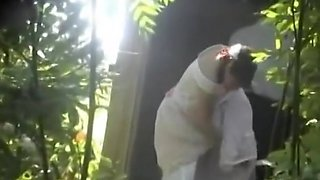 Bride and groom caught peeing