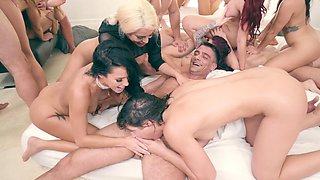 Sexy girls are having an orgy with some guys in the hot scene.