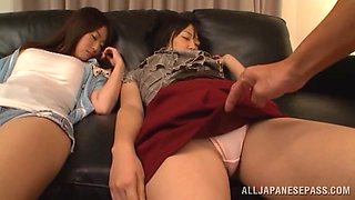 Asian teens share a hard cock in POV threesome