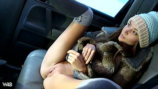 Stunning blonde babe Clover masturbates in car after winter walk