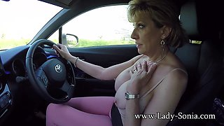 Lady Sonia flashing while driving