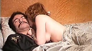Cute redhead classic lady on the bed eating nice big cock