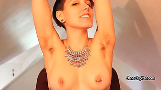 Jane Jupiter shows her pierced tits and hairy arm-pits