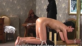 Oiled babe gets her firm ass punished by a nasty mistress