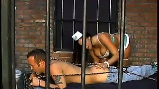 Wickedly hot nurse Gianna Michaels facesits a convict in the prison cell