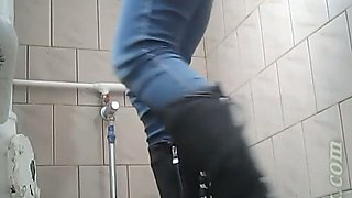 Sweet pale skin blonde teen in blue jeans urinates in the toilet