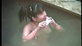 Kinky amateur chicks from Japan take hot outdoor bath and flashes tits