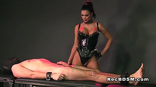 Femdom face sitting and handjob in dungeon