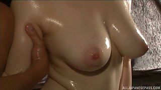 Big tit Japanese MILF gets oiled up and played with