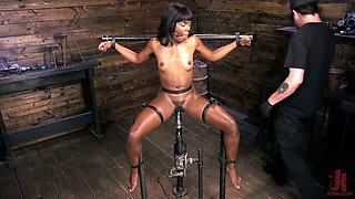 Ebony chick Ana Foxxx is restrained and punished in the BDSM room
