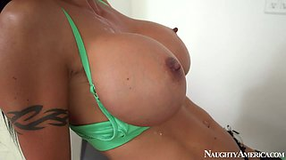 Well stacked  brunette Jewels Jade gives titsjob and sucks dick