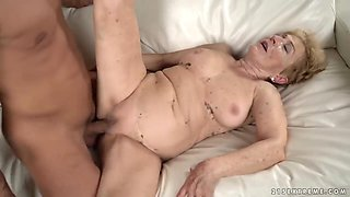 Blonde granny, Malya invited a handsome, black guy, Mugur to her place, to fuck him