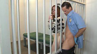 Ginger hottie in prison gets nailed by a horny guard