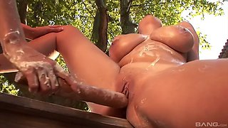 huge breasted lesbians toy their pussies with a rolling pin in a garden