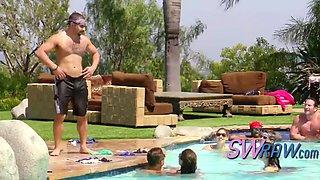 kinky swingers relaxing in pool