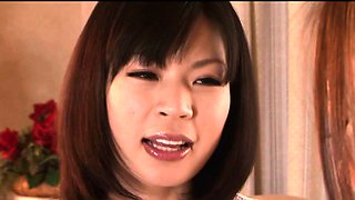 Japanese mature receives oral from babe in kitchen
