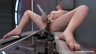 Horny Ruby Song gets her shaved pussy drilled by a machine