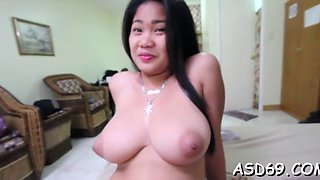 Asian girl goes for a big pecker