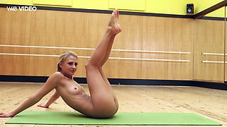 Yummy young gymnast Jati shows off her charming smooth pussy