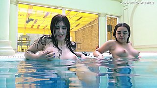 Two topless swimming babes Diana Rius and Sheril Blossom show tricks under the water
