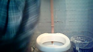 Blonde stranger milf in orange dress pisses in the toilet room