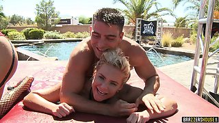 Big boobed pornstars have a fantastic wet orgy by the pool