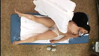 Cute Asian babes get sexually fulfilled on the massage table