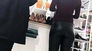 Street voyeur follows a stunning blonde in tight latex pants