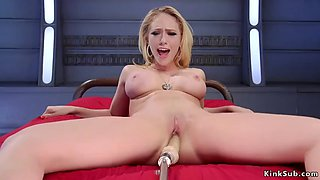 Busty blonde in silver shoes fucks machine