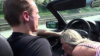 german blonde milf outdoor blowjob in car on public road