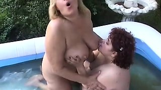 Chunky mature ladies enjoying the pleasures of lesbian sex in the pool