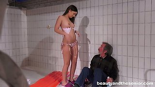 Brunette bimbo Anina Silk fucks old man in empty swimming pool