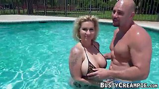 Handsome milf with nice curves doggy styled in the pool